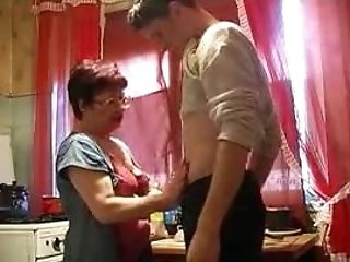 Mama And Boy In The Kitchen